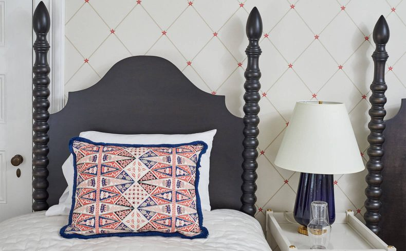 Twin bed with intricate pillow in the Dickinson room