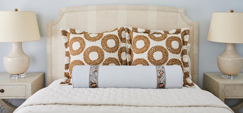 Queen bed between two lamps in the Wilson room