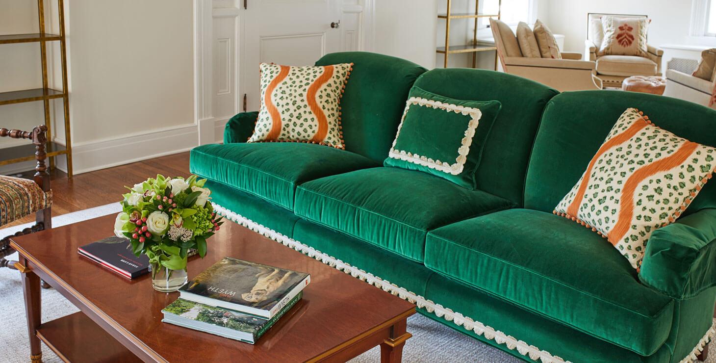 Green velvet couch in the Smith Steiner sitting room