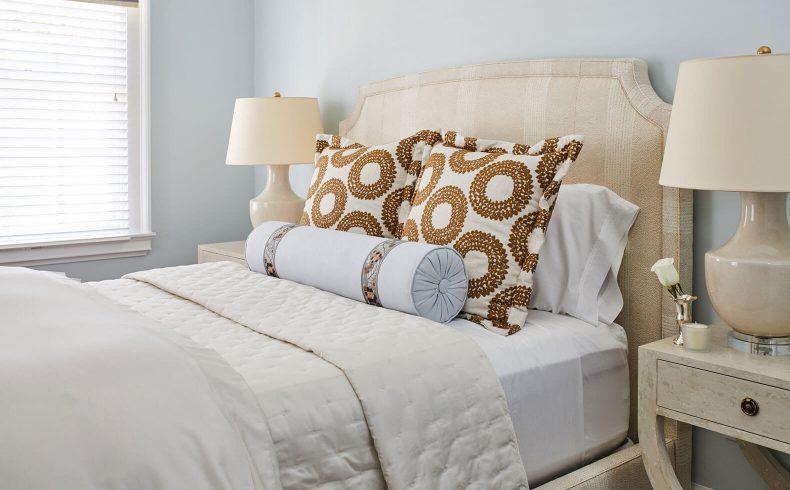 Comfortable queen bed between lamps in the Wilson room