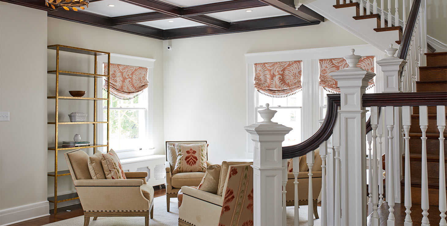 Four Chairs in our Living Room Area with ornate banister