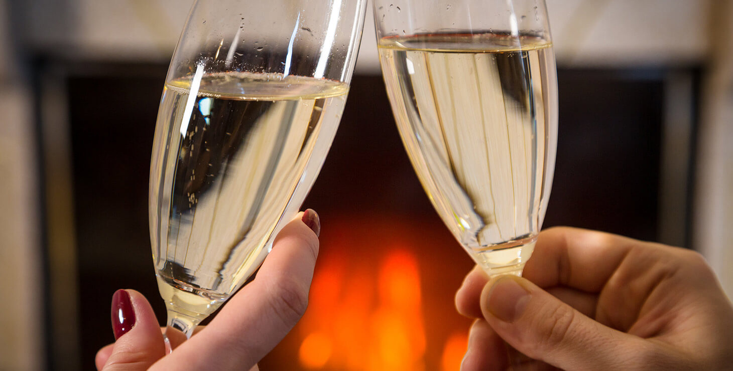 Champagne in front of a fireplace
