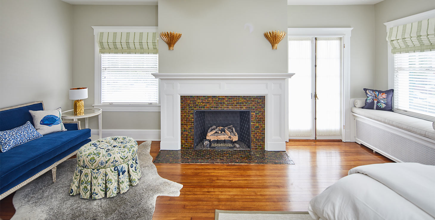 Fireplace and blue bench seating in Mooreland Room