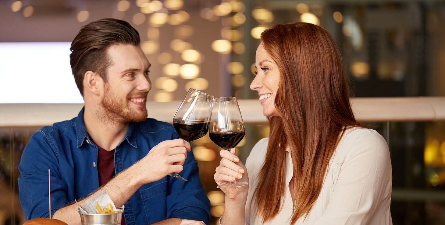 Couple with wine at a restaurant