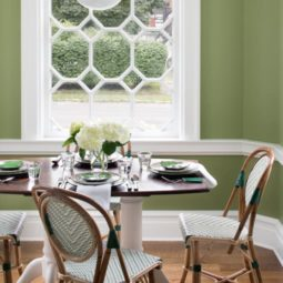 Dining table set in a room with geometric windows