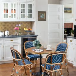 Small breakfast table in a kitchen with hardwood floors